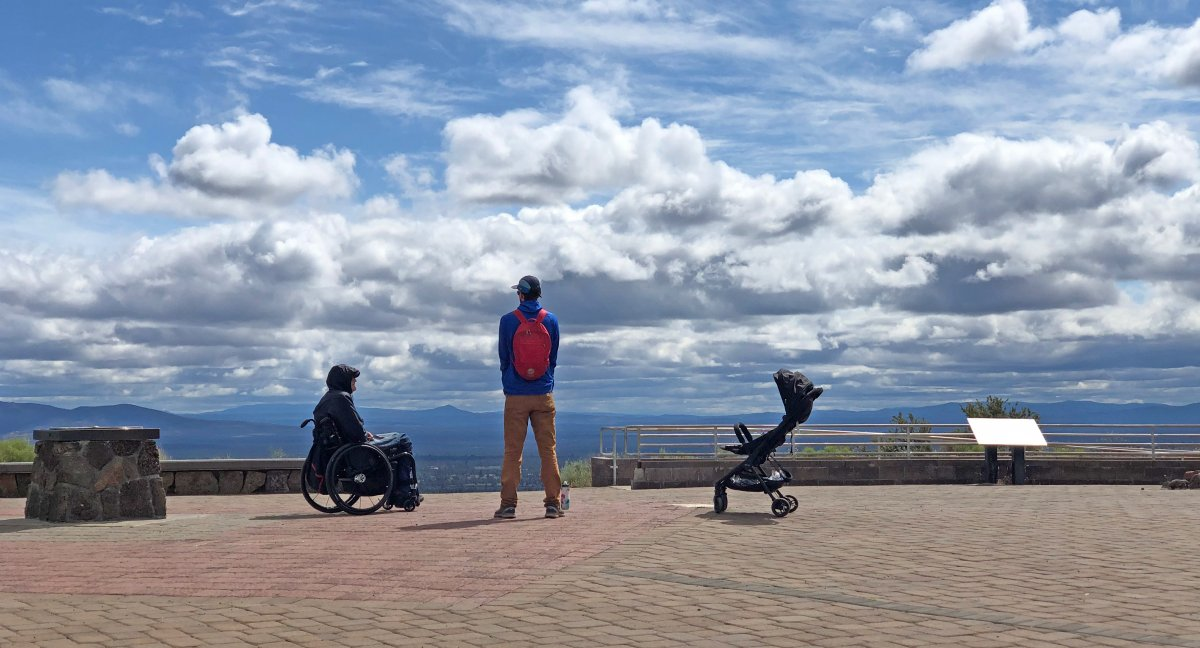 Two men wheelchair and stroller atop Pilot Butte in Bend Oregon