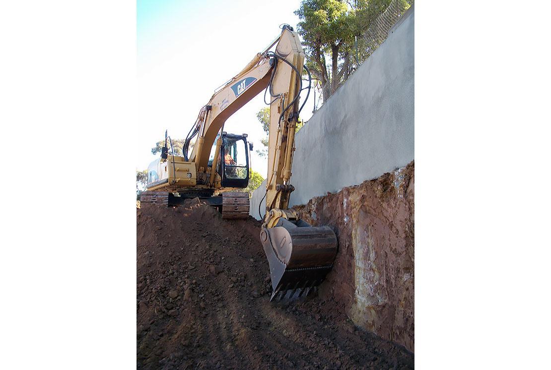 Shotcrete Property Line Site Wall Supported by Cantilevered Soldier Piles
